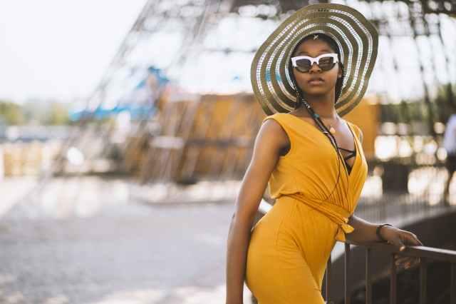 woman wearing yellow sleeveless dress
