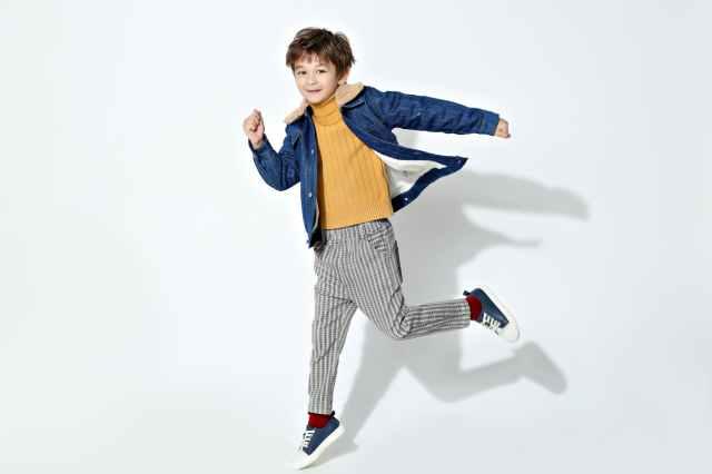 photo of boy wearing denim jacket
