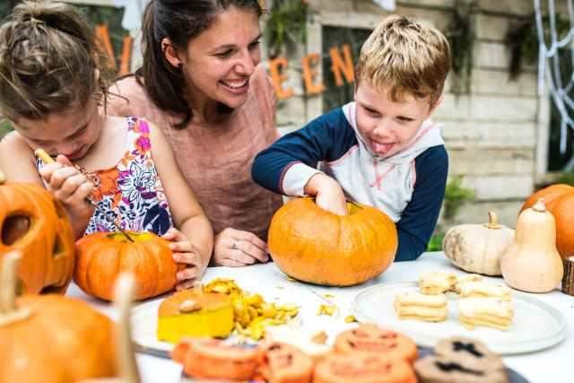 person holding pumpkin beside woman