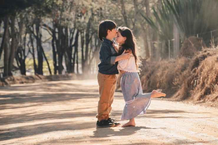 boy kissing girl s forehead