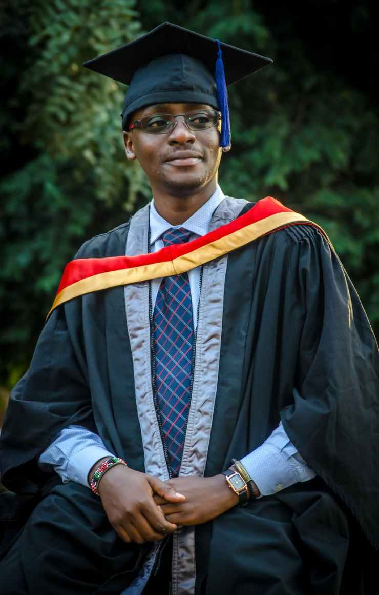 man wearing graduation gown