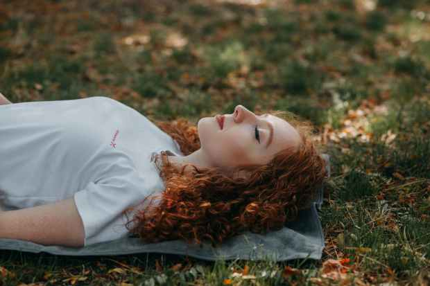 photo of woman laying on ground