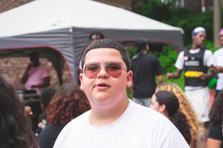 man wearing white crew neck shirt and sunglasses