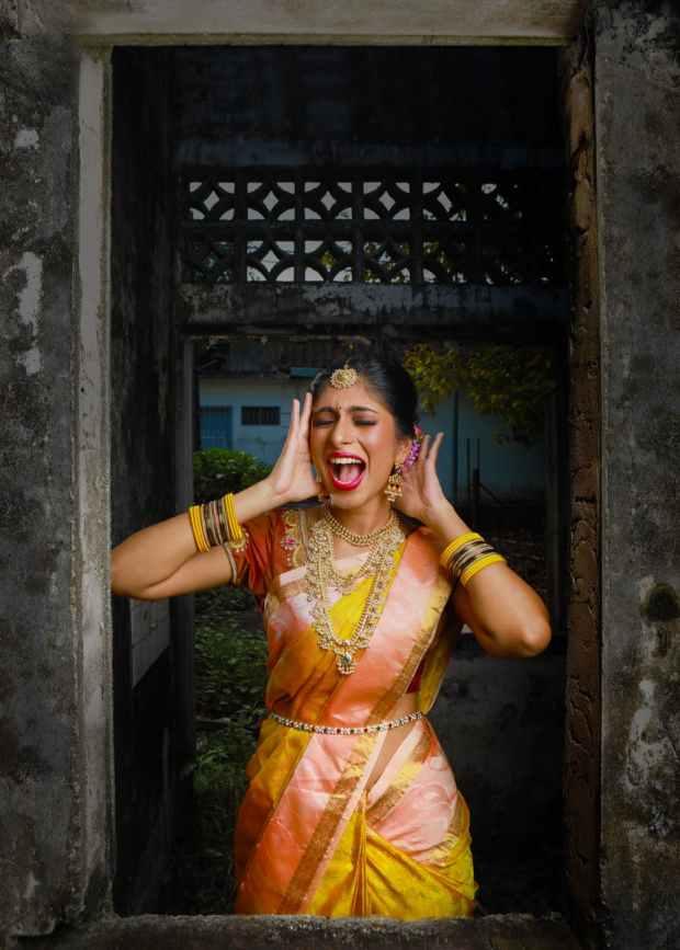 woman in yellow and orange sari dress