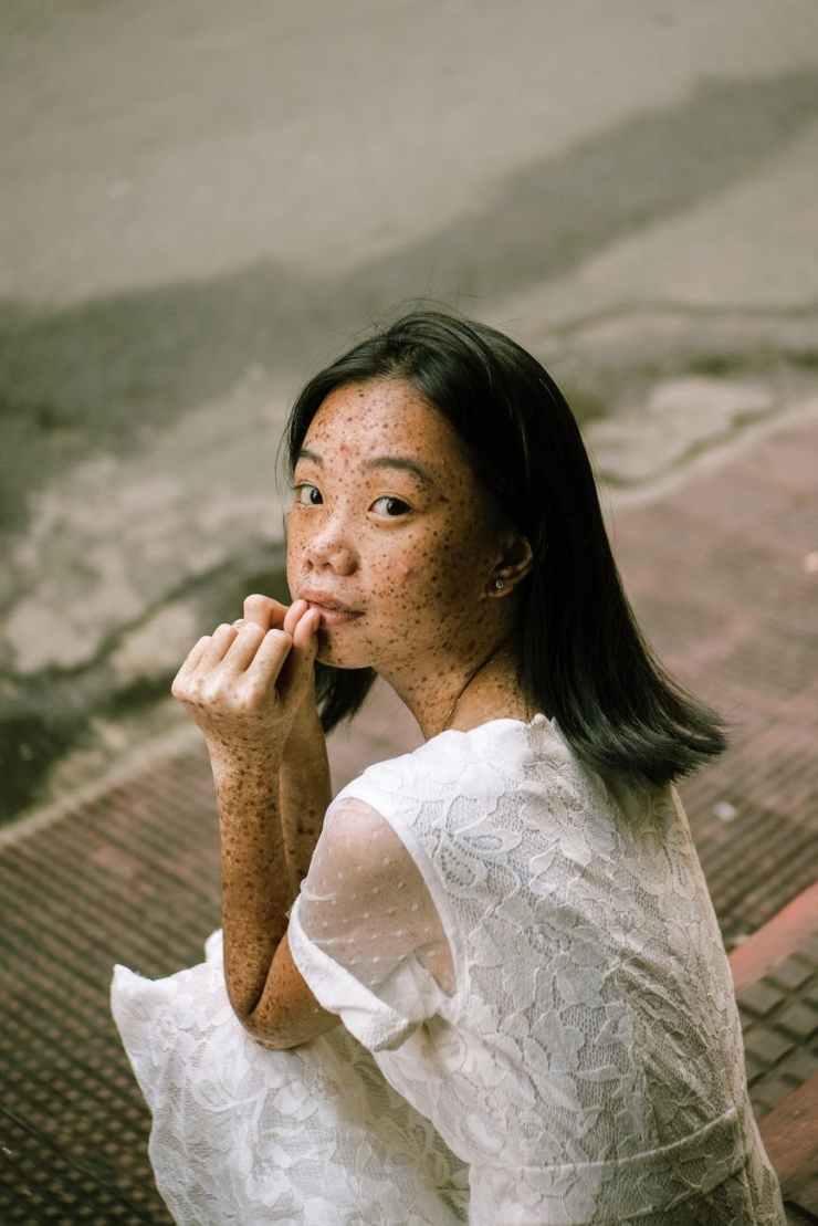 woman sits on pavement